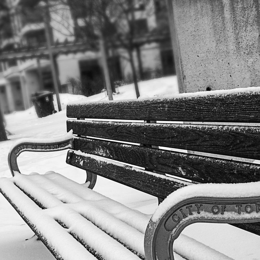 monochrome-photography-of-bench-covered-with-snow-894425