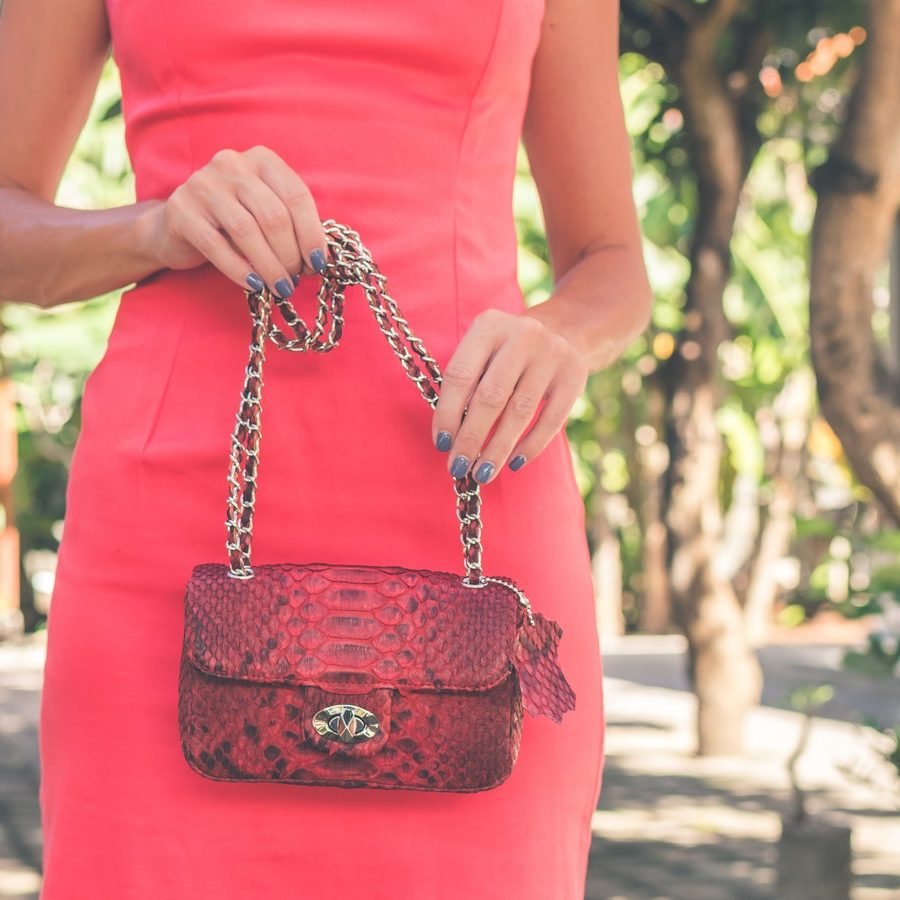 photo-of-woman-holding-red-bag-1022383